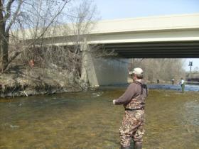 Fishermen work the Menomonee River near Miller Park.