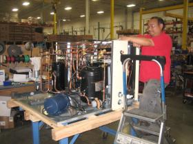 Desert Aire worker puts in extra hours to push a product to customer.