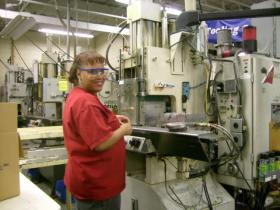 A worker operates a plastics molding machine at Pereles Bros. in Milwaukee. The company crafted its own training program for workers.