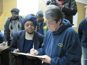 Kathy Smith was one of the first to sign a recall petition early Tuesday morning.
