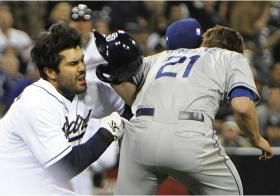 San Diego Padre Carlos Quentin charges Los Angeles Dodger Zach Greinke in a game.