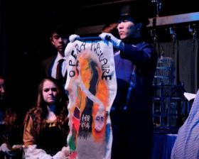 """Two students from the Wisconsin International Academy (center and left of center) perform in a scene from """"Phantom of the Opera."""""""