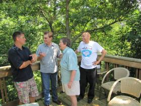 "New Wind Folk School organizers share their enthusiasm on June Eastvold's ""treehouse"" deck."