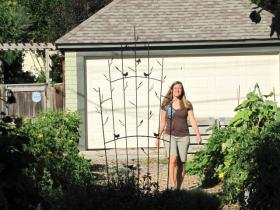 Melissa Scanlan enters a former neighborhood eyesore - now a community garden.