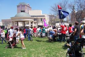 Immigration rights supporters rallied at Pere Marquette Park Wednesday.