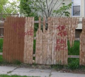 Graffiti marks the death of a gang member on the near north side of Milwaukee.