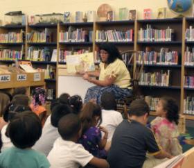 Children listen to a book being read at La Escuela Fratney.