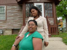 Jadea Mack (top) and her mother Andrea Mack outside their home in Milwaukee's central city.