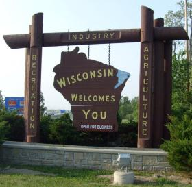 "Gov. Walker added the ""Open for Business"" message to the Wisconsin sign. But many business groups are pushing for a regional approach to creating and retaining jobs."
