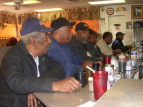 Black residents frequent Mister Perkins restaurant on the north side.