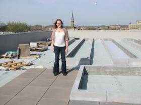 Stephanie Calloway with CORE/El Centro stands atop the Clock Shadow Building green roof during its formative stage
