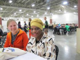Ashley Solsrud-Beckman (left) from St. Paul shares thoughts with Milwaukee resident Fannie Smith