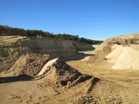 Superior Silica Sands mine occupies 135 acres in the Town of Auburn in Eau Claire County. Trucks carry the sand northeast to New Auburn where it is dried before being sent out by rail.