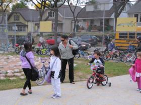 Families hit the pavement on Bike to School Day.