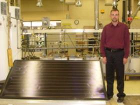 Bob Heideman shows off a solar panel that A. O. Smith will introduce in 2010.