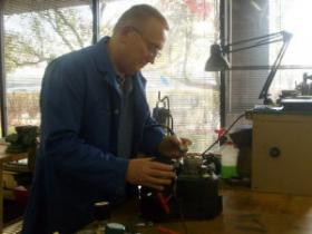 Al Lesak works on a motor design at A. O. Smith.