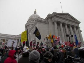 Gov. Walker's bold, conservative proposals outraged critics, who rushed to the Capitol in protest last winter.