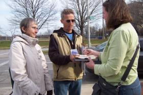 Public employee Sue Blaustein (left) helps circulate petitions to recall Gov. Walker.