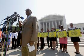 Charles White of the NAACP spoke Tuesday outside the U.S. Supreme Court building, after the court ruled that a provision of the Voting Rights Act is unconstitutional.