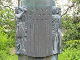 Artist Benjamin Hawkins designed the basrelief.  The stars represent the women's organization - Service Star Legion - that commissioned the project