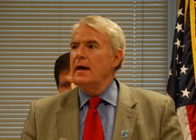 Mayor Barrett signed an ordinance to give pay raises to city employees who reside here