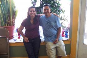 Christine Neumann-Ortiz (left) and Mauricio Galicia work together on Galicia's immigration status.