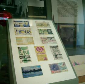 Vintage bus passes are on display in an exhibit at the Milwaukee Transit Museum at the downtown transit center.