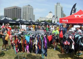 Vendors at the lakefront for the triathlon are selling swim suits, cycling helmets and other gear.