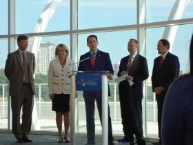Gov. Walker (at podium) addresses reporters at the opening news conference of the National Governors Association meeting this weekend in Milwaukee