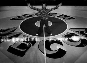 Pop artist Robert Indiana poses on his creation, the MECCA basketball court. It would be his largest work and the largest pop art painting in existence still today.