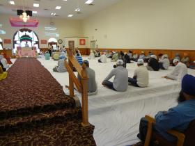 Worshippers gather for prayer at the Sikh Temple of Wisconsin in Oak Creek