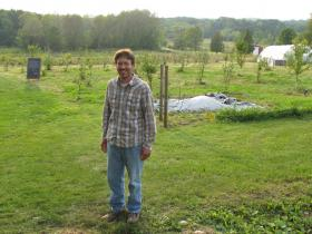 Keith Hiestand in permaculture orchard.