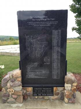 Local citizens erected memorial to families who farmed and were displaced from the land.