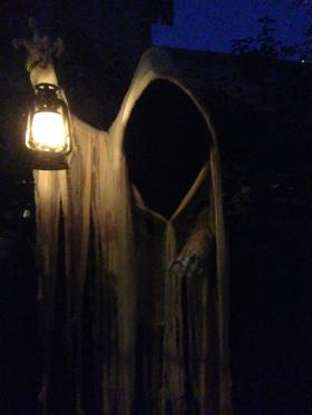 Homeowner Kyle Chen's newest addition to his house's Halloween scenes is this grim reaper ghost with a flickering lantern.