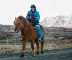 Outgoing U.S. Ambassador to Iceland Luis Arreaga on a horse at Laxness Horse Farm in Iceland.