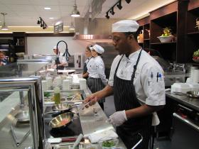 Don Ward (foreground) is part of the team of chefs trained through Harvest Market program.