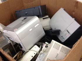 Computer components and other electronics await recycling at Goodwill in Bay View
