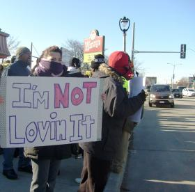 Demonstrators braved the cold during a rally calling for a hike in the minimum wage.