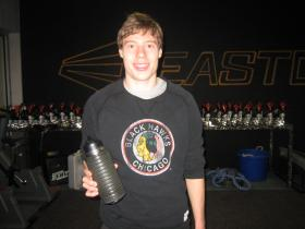 """Brian Hansen with the """"Bottle Bark"""" he created - a combo water bottle and rolling pad"""