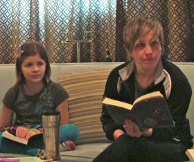 Coach Courtnie and Isabelle discuss the book the young members read