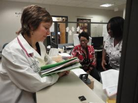 Dr. Lisa Zetley (left) of Children's Hospital and Medical College of Wisconsin treats many children in the foster care system in Milwaukee County.