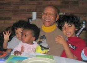 Dr. John Ridley with three of his grandchildren in 2007.