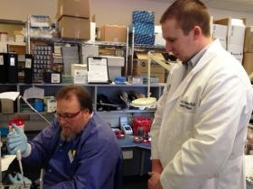 Nathan Ledeboer (right) is medical director of microbiology and molecular diagnostics at Froedtert and MCW. He helped develop a new test to diagnose bloodstream infections.
