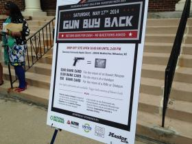 At a gun buyback event Saturday, people who turn in weapons will receive bank cards.