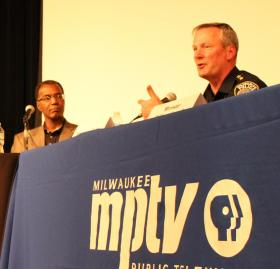 Clarence Johnson of Wisconsin Community Services and Milwaukee Police Chief Edward Flynn