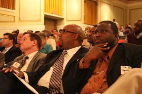 An attentive audience included US Attorney James Santelle (left) and the Rev. Leondis Fuller of Word of Hope Ministries (center)