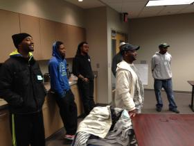 "At a fatherhood class at ""Next Door"" in Milwaukee, participants answer questions about the roles of men and women."