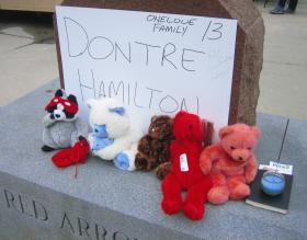 Family members set up a memorial in Milwaukee's Red Arrow Park