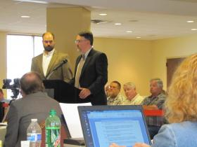 DNR large carnivore specialist David McFarland (left) and land division manager Kurt Thiede addressed the Natural Resources Board.