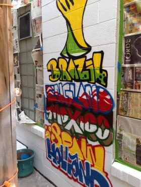 Graffiti is filling up empty cinder block walls outside The Highbury pub in Bayview to greet 2014 World Cup fans starting Thursday.